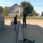 Seth watching Trent wax that rail